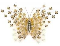Золотая брошь в виде бабочки