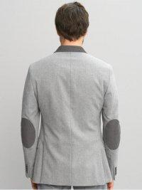 Зачем нужны заплатки на локтях пиджака